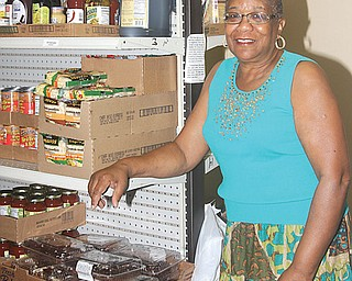 """Jacqueline """"Jackie"""" Burley, of Protestant Family Service of the Greater Youngstown Area Inc., reminds people that the needs of those with limited resources don't take a summer vacation."""