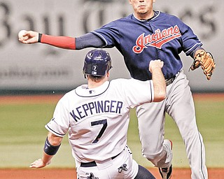 Cleveland Indians shortstop Asdrubal Cabrera, right, throws to first base to complete the double play on Tampa Bay Rays' Desmond Jennings after putting out Jeff Keppinger at second base during the fourth inning of a game Monday in St. Petersburg, Fla.