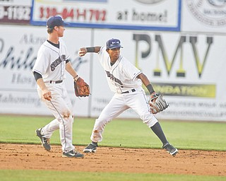 Scrappers shortstop Jairo Kelly sets himself for a throw while third baseman Joe Wendle watches during their 7-3 victory over State College.