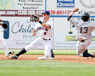 Scrappers Joe Sever, center, waits for a throw as Jammers Yeison Hernandez tries to steal second base. Hernandez was out on the play. Robel Garcia, left, had the game-winning hit for Mahoning Valley in the 2-1 win.