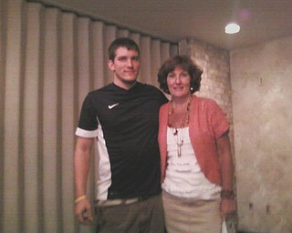 At a June 13th installation dinner, the Youngstown Mothers of Twins Club awarded its annual $500 scholarship to Scott Brandenstein, a junior enrolled in Youngstown State University's business program. He is the son of George and Sue Brandenstein. He is pictured here with his mother, who has been a member of the club for 22 years. The club meets the second Wednesday of the month, September through June, at the Davidson-Becker Family Center in Struthers.