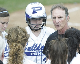 Poland softball coach Reid Lamport, right, talks with his players during the 2011 Division II regional softball  final at Akron Firestone Park. After nearly five decades of coaching, Lamport will be hanging up his cleats and retiring.