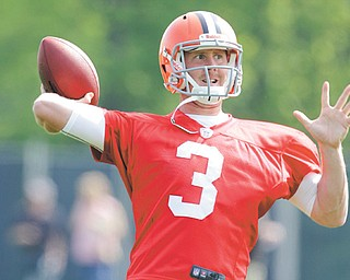 Browns quarterback Brandon Weeden, shown here during a rookie camp practice in May, signed a four-year, $8.1 million contract on Tuesday. He is expected to win the starting job this summer.