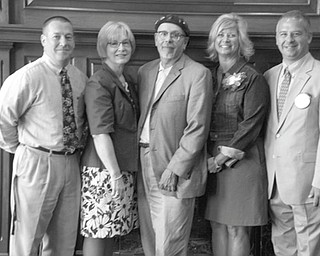 The Rotary Club of Youngstown recently installed officers for the 2012-2013 club year. From left to right are: Paul Garchar, vice president; Carol Chamberlain, treasurer; Ronald Cornell Faniro, president; Becky Keck, secretary; and Scott R. Schulick, president-elect. The club was established in 1915 and meets each Wednesday at noon at the Youngstown Club. For membership information call 330-743-8630.