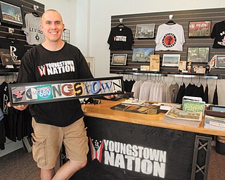 Phil Kidd, who owns and operates Youngstown Nation, a nonprofi t consignment store on North Phelps Street in downtown Youngstown, says business has been steady since the store opened July 7. Kidd is selling rare and historic items from Youngstown, as well as T-shirts and other gifts.