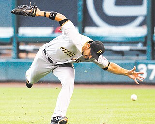 Pittsburgh Pirates' Garrett Jones (46) misses a catch allowing Houston Astros' J. D. Martinez to triple in the fifth inning of a baseball game Sunday in Houston. The Astros won 9-5.