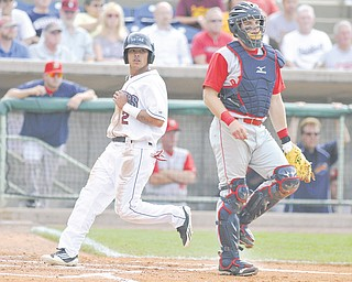 Scrappers base runner Aaron Siliga (2) crosses home plate behind Brooklyn Cyclones catcher Kevin Plawecki to score the Mahoning Valley's first run of the game. Siliga also tripled, but the Scrappers fell to Brooklyn, 10-5, in front of 3,398 fans at Eastwood Field.