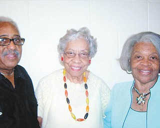 Promoting the Northeast Homeowners and Concerned Citizens Association's fundraiser and recognition banquet set for Aug. 24 are, from left, Bennie Harrell; Olla Tate, publicity chairwoman; and Betty Crafter Royal, fundraiser chairwoman.