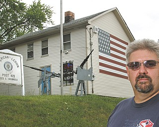 American Legion Post 472 has started a Road to Remembrance community campaign to help finance an expansion of its post home and make it handicap-accessible. Robert Raver, Post 472 commander, stands in front of the post home at 323 E. Indianola Ave., on Youngstown's South Side. The post plans to build a 24-by-34-foot addition, which will include two handicap-accessible restrooms off the rear of the building.