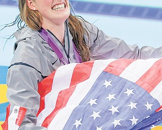 America's Missy Franklin celebrates winning the women's 200-meter freestyle swimming semifinal Monday at the Aquatics Centre in the Olympic Park in London. The 17-year-old struck gold earlier in the 100-meter backstroke.
