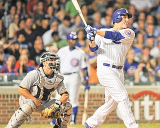 Pirates catcher Michael McKenry watches as the Cubs' Anthony Rizzo connects for a three-run home run in the fifth inning of Monday's baseball game in Chicago. Chicago routed Pittsburgh, 14-4.