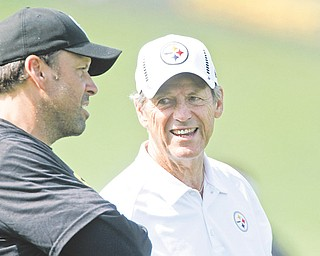 Pittsburgh Steelers offensive coordinator Todd Haley, left, talks with defensive coordinator Dick LeBeau during practice at the Steelers' training camp in Latrobe, Pa.