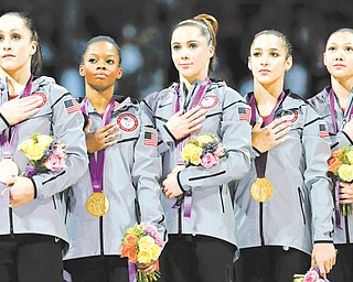 U.S. gymnasts Jordyn Wieber, left, Gabrielle Douglas, McKayla Maroney, Alexandra Raisman and Kyla Ross stand for their national anthem during the medal ceremony during the Artistic Gymnastic women's team final at the 2012 Summer Olympics on Tuesday in London. Team U.S. won the gold.