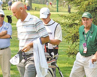 Phil Clacko of Coitsville, right, stands near PGA golfer Stewart Cink (holding hat) and Cink's caddie during the 2011 Bridgestone Tournament in Akron when Clacko was Cink's spotter.