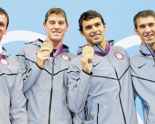 United States swimmers Ryan Lochte, left, Conor Dwyer, Ricky Berens and Michael Phelps pose with their gold medals for the men's 4x200-meter freestyle relay swimming final at the Aquatics Centre in the Olympic Park during the 2012 Summer Olympics in London on Tuesday.