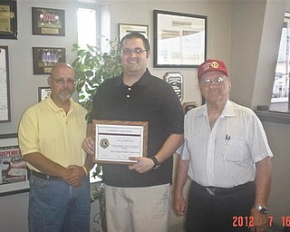 The Canfield Lions Club recently presented Haus Motors with a plaque to thank them for their many years of dedication to the club. Haus Motors has partnered with the Lions in many projects. Pictured are King Lion Dan Grossman, left; Lion Chris Haus, center, receiving the award; and Immediate Past King Lion Harry Pancher, right. The Canfield Lions Club was chartered in 1978, is in its 34th year and has 50 members. The club is currently recruiting. Members meet at A La Cart Catering the first and third Thursdays of each month. For information call Pancher at 330-533-3669.
