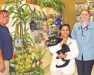 The Humane Society of Columbiana County will host a Chips and Dips (microchips and dog-bathing dips) event from 11:30 a.m. to 1:30 p.m. Saturday at their ROCC and Rescue Center, 1825 S. Lincoln Ave., Salem. Pictured from left to right are Stephanie Peterson of the society, Dr. Sarah Hopkins, holding Felix, and Dr. Alicia Boyce. Microchips will cost $20, which will include registration, or $23 for the mini chip, which is perfect for cats and small dogs. Dog grooming, which includes a nail trim, ear cleaning, perfume and bandana, will cost $10 for small dogs, $15 for medium dogs and $20 for large dogs. Veterinarians and groomers have donated their time, so all proceeds can go toward medical costs to animals in the society's care. From 11 a.m. to 3 p.m. there also will be a ROCC and Reunion Day. Attendees are welcome to take their pets for contests and giveaways. Those who donate shelter supplies such as kitty litter, laundry detergent, latex gloves and gift cards will receive event T-shirts. Gina McQuillian of State Farm Insurance, adjacent to HSCC, will host a rummage sale from 9 a.m. to 3 p.m. and Dairy Queen, also adjacent to the center, will have hot dog and cool treat deals to benefit HSCC.