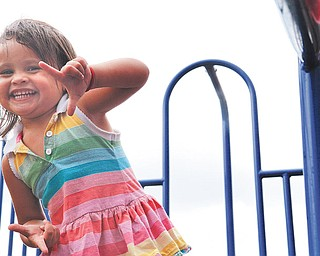 Clara Setting, 2, plays at Waddell Park in Niles, Ohio on July 27, 2012.