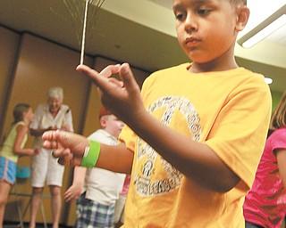 Caleb Sakara, 6, of Youngstown, practices his  balancing skills at the workshop.