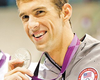 American swimmer Michael Phelps has 19 Olympic medals to date. That makes him the most decorated Olympian, but does it mean he's the greatest? Opinions differ.