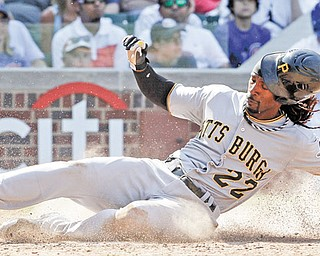 Pirates baserunner Andrew McCutchen slides in to home to score on a single by Garrett Jones during the eighth inning of Wednesday's game against the Chicago Cubs at Wrigley Field. Pittsburgh scored five runs in the eighth to pummel the Cubs, 8-4.