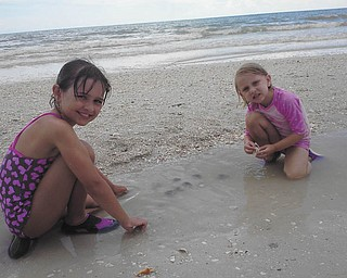 Marissa and Camryn play on the beach. Photo sent in by Rich T.