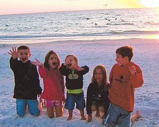 Evan and Madison Macko and Paulie, Anna and William Laczo, all grandchildren of Paul and Vicki Laczo of Poland, enjoy some time together at Siesta Keys, Fla., in 2010. Photo sent in by Vicki Laczo.