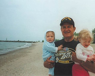 Bob DeFelice holds his 7-month-old grandson Caden and 21-month-old granddaughter Caylee in this photo taken in Geneva in May 2006.