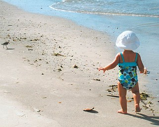 Mena Monroe, 22 months, takes a stroll on St. Pete Beach in Florida. She's the granddaughter of Russell and Ellen Monroe of Austintown.