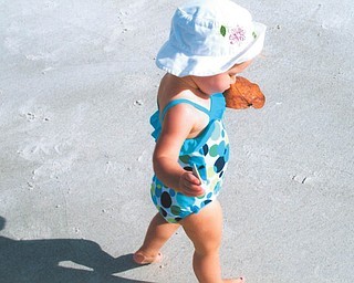 Mena Monroe, 22 months, delights in having fun at St. Pete Beach in Florida. She's the granddaughter of Russell and Ellen Monroe of Austintown.