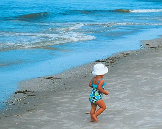 Mena Monroe, 22 months, takes a stroll on St. Pete Beach in Florida. She's the granddaughter of Russell and Ellen Monroe of Austintown