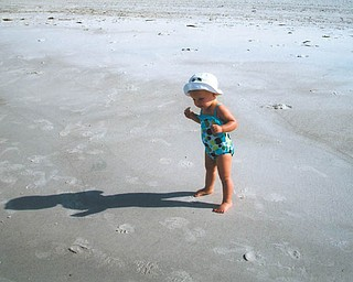 Hey, who's that shadow? Mena Monroe, 22 months, delights in having fun at St. Pete Beach in Florida. She's the granddaughter of Russell and Ellen Monroe of Austintown.