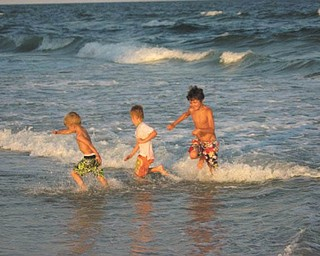 Jennifer Walker sent in this photo of her sons, Benjamin, Owen and Zachary Walker, fighting the waves at Myrtle Beach in 2010.