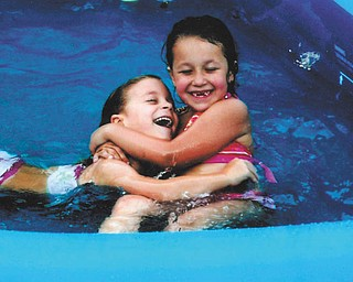 Cousins Hunter Oliva and Nevaeha Carcido have some water fun.