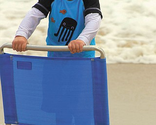 Sam Manning, 2, has a giggle at Bethany Beach in July. Photo sent in by Joyce Buzzacco.