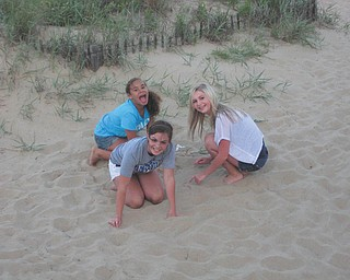 Delia Walkowiec of Boardman spends time with Julie and Katelyn Matijasic of Hagerhill, Ky., while on vacation in Virginia Beach. Photo sent in by Crystal Walkowiec.