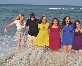 """The """"Kuhns Cousins"""" were posing for this photo at the Outer Banks, N.C., when they were surprised by a pretty large wave. From left are Allison Dickey, Ethan Parks, Devon Parks, Lauren Parks, Jenny Fisher and Katie Lane. Photo submitted by Dawn Dickey."""
