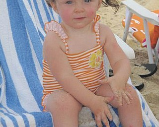 Naomi Lane, granddaughter of Dave and Dawn Dickey of North Lima, experiences the beach for the very first time this year.