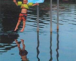 Paul Krol enjoys the slide at Speece Lake in Berlin Center. Photo by Lana VanAuker of Canfield.