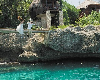"""Sunny Osman of Youngstown sent in this photo, which was taken in Jamaica during her destination wedding. They had just said, """"I do."""" And yes, Sunny is wearing her wedding dress!"""