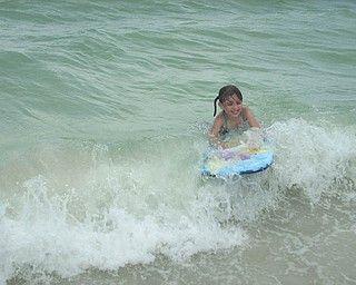 """Kelly Alexander sent in this photo of her daughter Marissa riding the waves at Fort Myers Beach in Florida. """"I love the pure happiness on her face!"""" Kelly writes."""