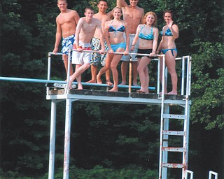 Partygoers enjoy Leanna Hartsough's swim party at Speece Lake in Berlin Center. Photo by Lana VanAuker of Canfield.