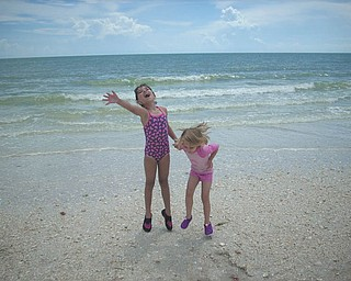 Sisters Marissa and Camryn jump for joy on the beach in Florida. Photo sent in by Kelly Alexander.
