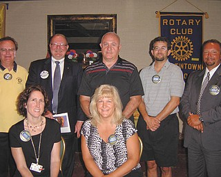 Leaders of Austintown Rotary Club for the 2012-13 term who were sworn in at the July 16 meeting are, seated, Jennifer Connolly, left, secretary, and Tracy Kaglic, community service; and standing from left, Ron Carroll, president; Chuck Baker, who conducted the installation; Mal Culp, treasurer; Kristopher Sperry, international service chairman; and Mark Cole, vice president. They are among more than 1.2 million Rotarians in  33,790 clubs worldwide.
