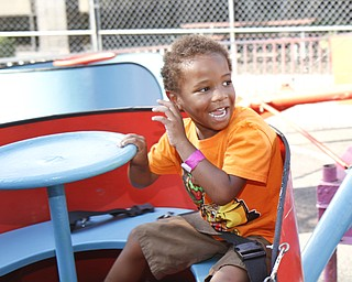 Xavier McDougald, 4, takes a spin on a ride with his brother at the Greater Youngstown Italian Festival on August 4, 2012.