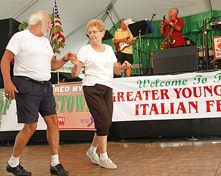 Paul Karabian and Helen Mayorgan start to dance during a song performed by Jack Vasko and Company at the Greater Youngstown Italian Festival on August 4, 2012.
