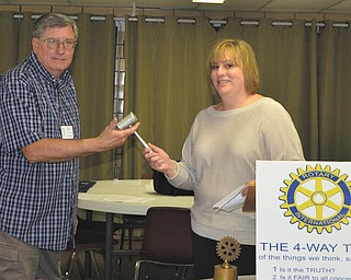 Traci Thompson, outgoing president of East Palestine Rotary Club, passes the gavel to John Davis, incoming president for 2012-13. Serving with Davis are Mary Ann Steiner, vice president; Roger  Linsley, treasurer; and Bonnie Davis, secretary.