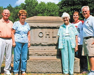 Standing at the tombstone of Michael Ohl, founder of Ohltown, are descendants, from left, Lester Handwork, Mary Liming, Margaret Grace and Cheryl and Lloyd Zimmet. The 135th Ohl family reunion will take place Aug. 19 at Ohltown United Methodist Church, Mineral Ridge.