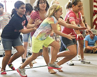 (L-R) Erin Jackson, 9, of Boardman, Emily Jackson, 11, of Poland, Ava Bosnjak, 6, of Poland, and Kyla Jackson, 11, of Struthers, run to collect eggs during a 'Live Pacman' game held by the Boardman Library on August 9, 2012.