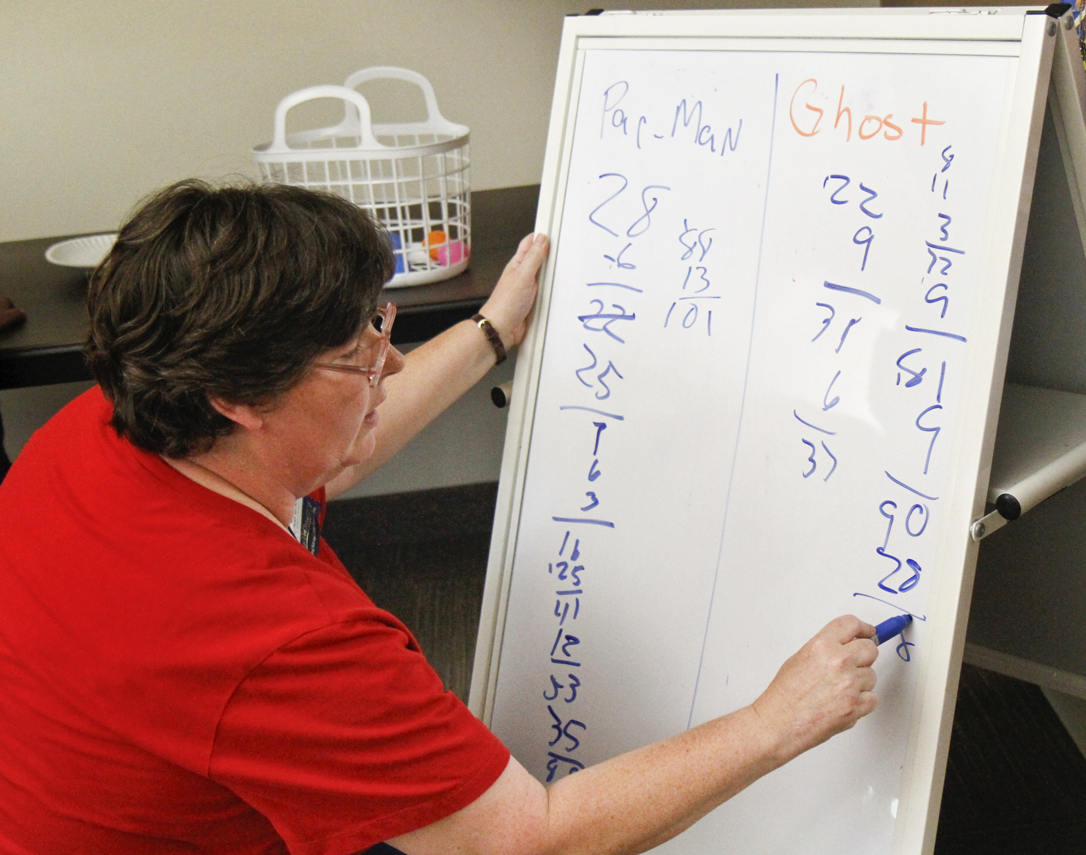 Karen Saunders of Boardman, Ohio tallies the points between the Pacman group and the Ghost group during the 'Live Pacman' game hosted by the Boardman Library on August 9, 2012.